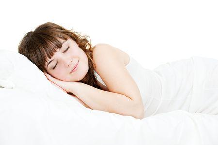 nightie: pretty sleeping woman in white nightie lying in the bed