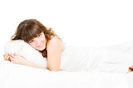 nightie: young pretty girl in white nightie lying in the bed Stock Photo