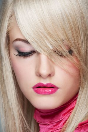 close-up portrait of beautiful blonde looking down photo
