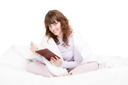 beautiful girl reading book in the bed photo