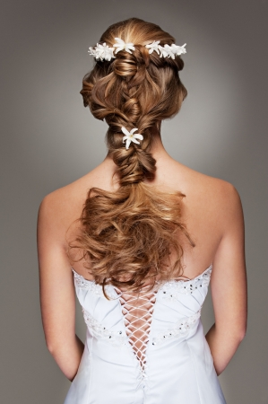woman back of head: back view of beautiful haircut with small flowers
