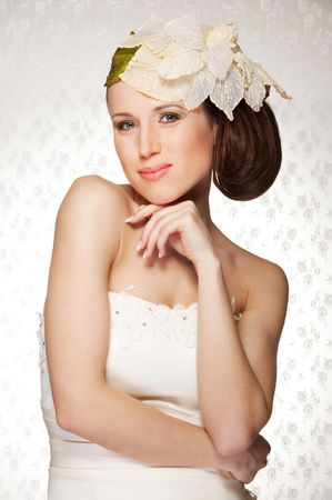 portrait of elegant young woman with flower on her head Stock Photo - 6595237