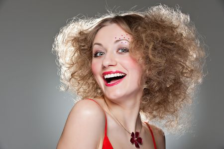 unconcerned: portrait of happy unconcerned girl with curly hair Stock Photo