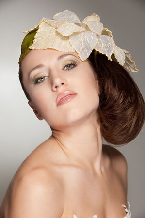 portrait of stylish woman with big flower on her head  photo