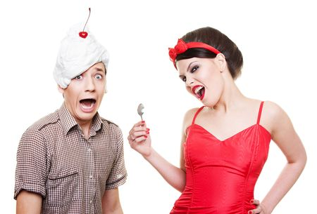 funny picture of man with dessert on his head and woman with spoon photo