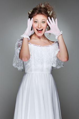 portrait of amazed beautiful woman in white dress Stock Photo - 6643756