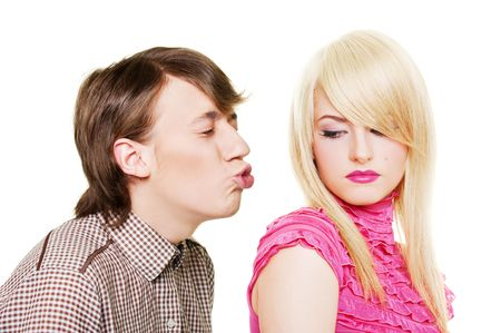 young man want to kiss inaccessible blonde. isolated on white