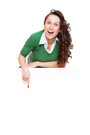 rapturous: enthusiastic woman pointing at copyspace. isolated on white Stock Photo