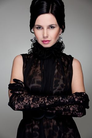 stylish young woman in evening dress and gloves photo