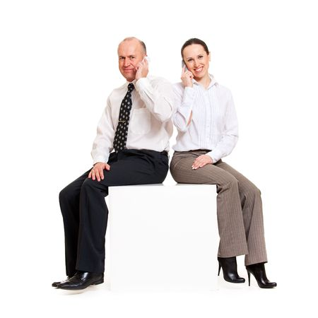 smiley business people with telephones sitting on copyspace photo