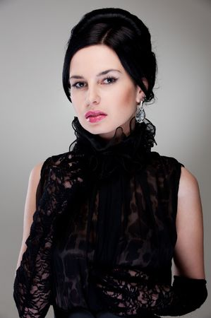 portrait of alluring young woman in black evening dress photo