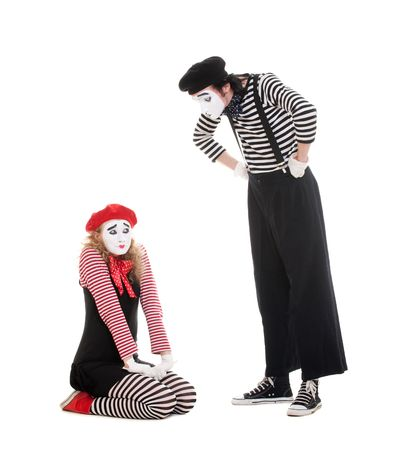 portrait of mimes. angry man and guilty woman. isolated on white photo