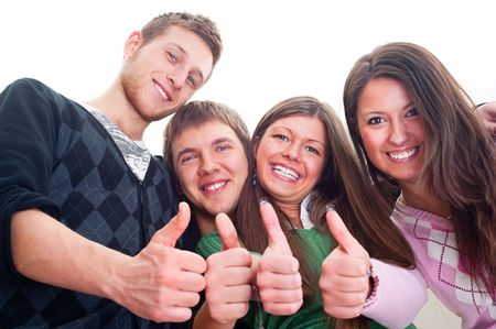four fingers: four cheerful friends showing thumbs up over white background Stock Photo