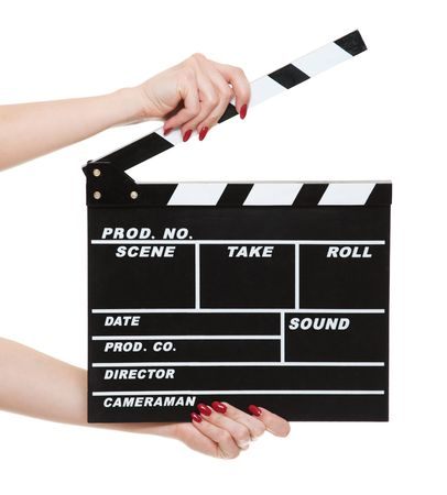 cinema clapboard in female hands isolated on white background   photo
