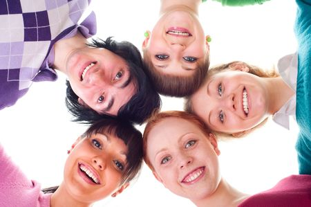 group of happy young people in circle. isolated on white photo