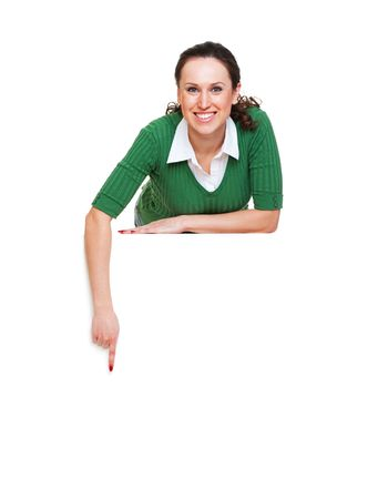 happy woman pointing at something. isolated on white background photo