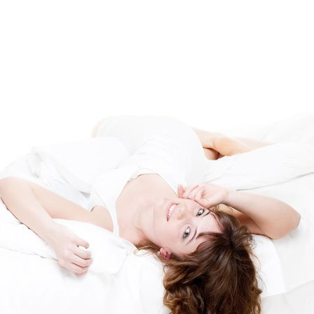 luxuriate: lovely young woman resting in the white bed Stock Photo