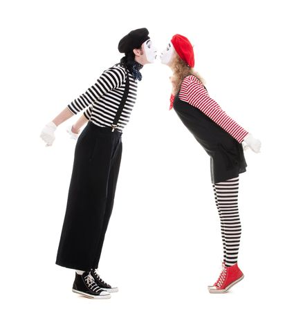 funny love: loving couple of mimes kissing. isolated on white background
