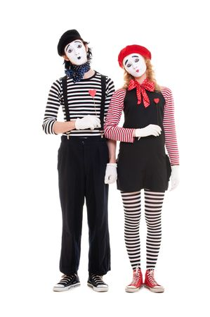loving couple of mimes with red hearts. isolated on white photo