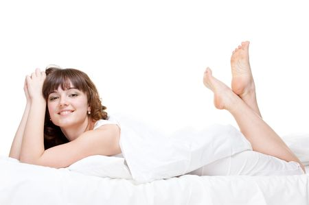 luxuriate: young healthy woman lying in the bed over white background Stock Photo