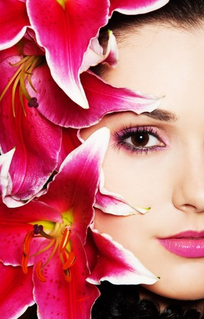close-up portrait of beautiful woman with pink lilies photo