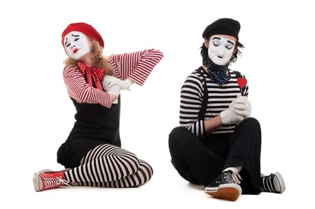 portrait of mimes. broken heart. isolated on white background photo