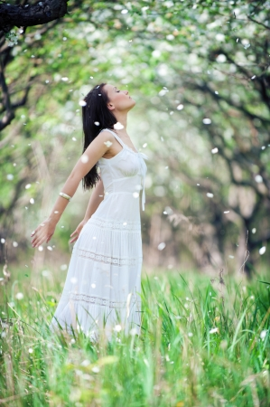 portrait of carefree young woman in white dress photo