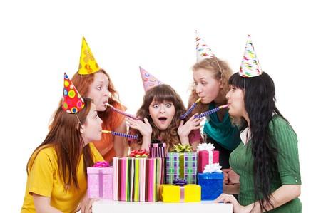 cheerful girls celebrating happy birthday. isolated on white background photo