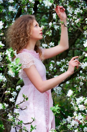 portrait of lovely woman in white flowers photo