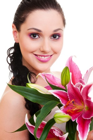 portrait of lovely woman with bunch of flowers photo
