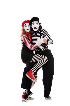 frighten: portrait of frightened mimes. isolated on white background Stock Photo