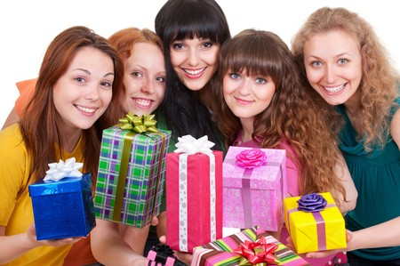 portrait of smiley women with motley gift boxes photo