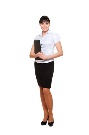 full-length portrait of young businesswoman with folder. isolated on white background photo