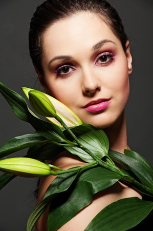 portrait of attractive woman with green leafs photo