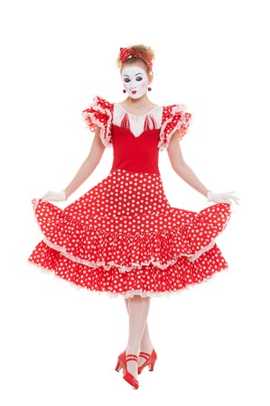beautiful mime in red dress posing against white background  photo