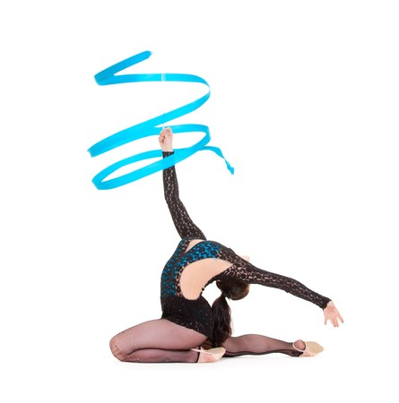 flexible gymnast dancing with blue ribbon. isolated on white background photo