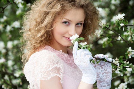 portrait of lovely blonde in blooming garden Stock Photo - 7291858