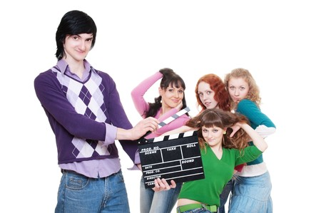 film making: man with clapboard over women. isolated on white background