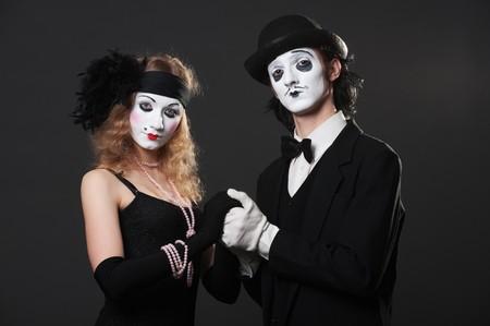 retro portrait of mimes over black background  photo