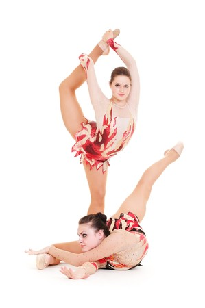 portrait of two flexible beautiful gymnasts. isolated on white background photo