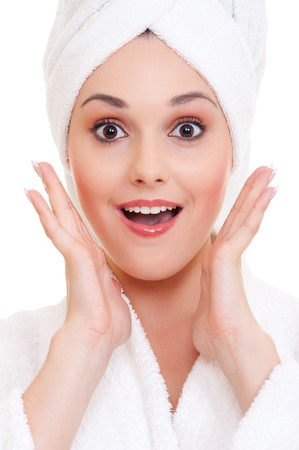 unexpectedness: portrait of surprised young woman in white towels