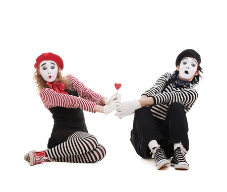 actors: funny portrait of two mimes with red heart. isolated on white background Stock Photo
