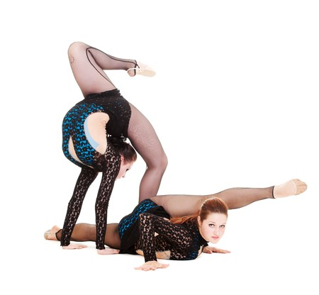 contortionist: two pretty gymnasts posing over white background