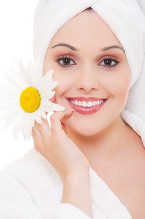 portrait of beautiful woman with camomile over white background  photo