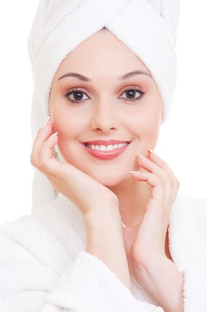 portrait of beautiful woman with white towel on her head photo