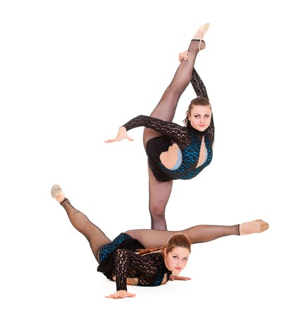 two young women showing rhythmic gymnastics. isolated on white background photo