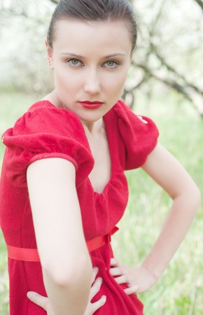 lively portrait of beautiful model in red dress  photo
