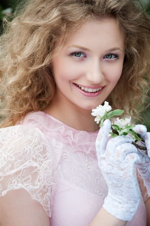 portrait of beautiful young woman in white gloves with flowers  photo
