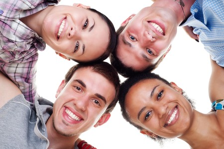 group of happy young people in circle. isolated on white background photo