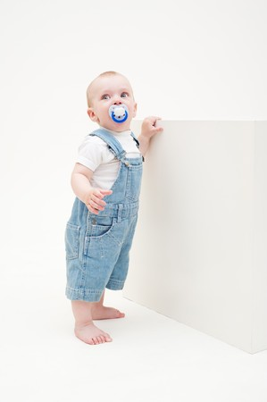 portrait of little boy in jean dungarees Stock Photo - 7348590